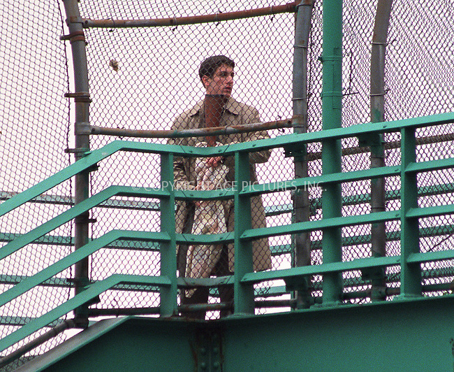 """***EXCLUSIVE***..Director Woody Allen making a movie, """"Anyting Else"""" on the East River Esplanade at 51st Street in New York. In this scene, Jason Biggs, dumps a sniper rifle into East River. June 13, 2002.  Please byline: Alecsey Boldeskul/NY Photo Press.   ..*PAY-PER-USE*      ....NY Photo Press:  ..phone (646) 267-6913;   ..e-mail: info@nyphotopress.com"""