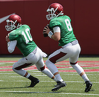NWA Democrat-Gazette/ANDY SHUPE<br /> Arkansas quarterbacks Brandon Allen (10) and brother Austin Allen work through drills Thursday, Aug. 13, 2015, during practice at the university practice field in Fayetteville.