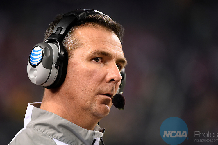 12 JAN 2015:  Head Coach Urban Meyer of the Ohio State University calls out a play against the University of Oregon during the College Football Playoff National Championship held at AT&T Stadium in Arlington, TX.  Ohio State defeated Oregon 42-20 for the national title.  Jamie Schwaberow/NCAA Photos