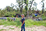 """Amanda Briscoe wanders what is left behind of her home by a tornado that destroyed many homes in Vaughn, Georgia. """"We didn't realize our community was gone 'til sun-up,"""" she said. Months later, the community is still picking up the pieces."""