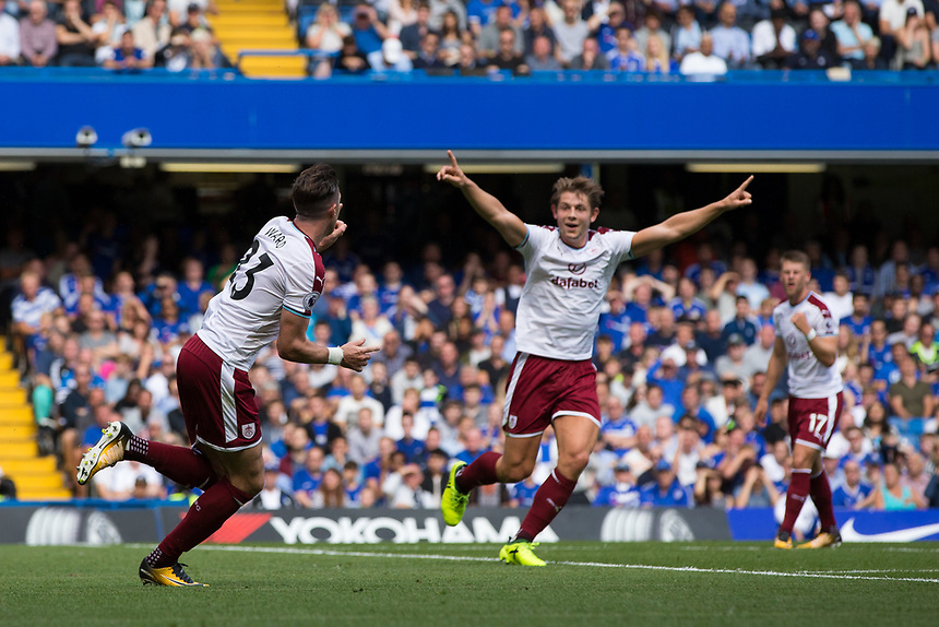 Burnley's Stephen Ward wheels away to celebrate scoring his sides second goal <br /> <br /> Photographer Craig Mercer/CameraSport<br /> <br /> The Premier League - Chelsea v Burnley - Saturday August 12th 2017 - Stamford Bridge - London<br /> <br /> World Copyright &copy; 2017 CameraSport. All rights reserved. 43 Linden Ave. Countesthorpe. Leicester. England. LE8 5PG - Tel: +44 (0) 116 277 4147 - admin@camerasport.com - www.camerasport.com