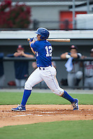 Anderson Miller (12) of the Burlington Royals follows through on his swing against the Danville Braves at Burlington Athletic Park on July 12, 2015 in Burlington, North Carolina.  The Royals defeated the Braves 9-3. (Brian Westerholt/Four Seam Images)