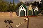 Three bird-house mail boxes.