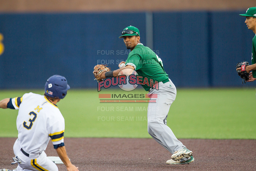 Eastern Michigan Hurons shortstop Marquise Gil (4) turns a double play as Michigan Wolverines baserunner Cody Bruder (3) slides into second base on May 3, 2016 at Ray Fisher Stadium in Ann Arbor, Michigan. Michigan defeated Eastern Michigan 12-4. (Andrew Woolley/Four Seam Images)