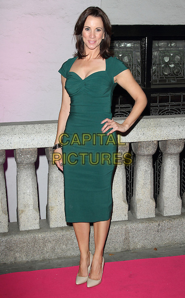 Andrea McLean<br /> The Inspiration Awards For Women 2013, Cadogan Hall, Sloane Terrace, London, England.<br /> October 2nd, 2013<br /> full length green dress hand on hip<br /> CAP/ROS<br /> &copy;Steve Ross/Capital Pictures