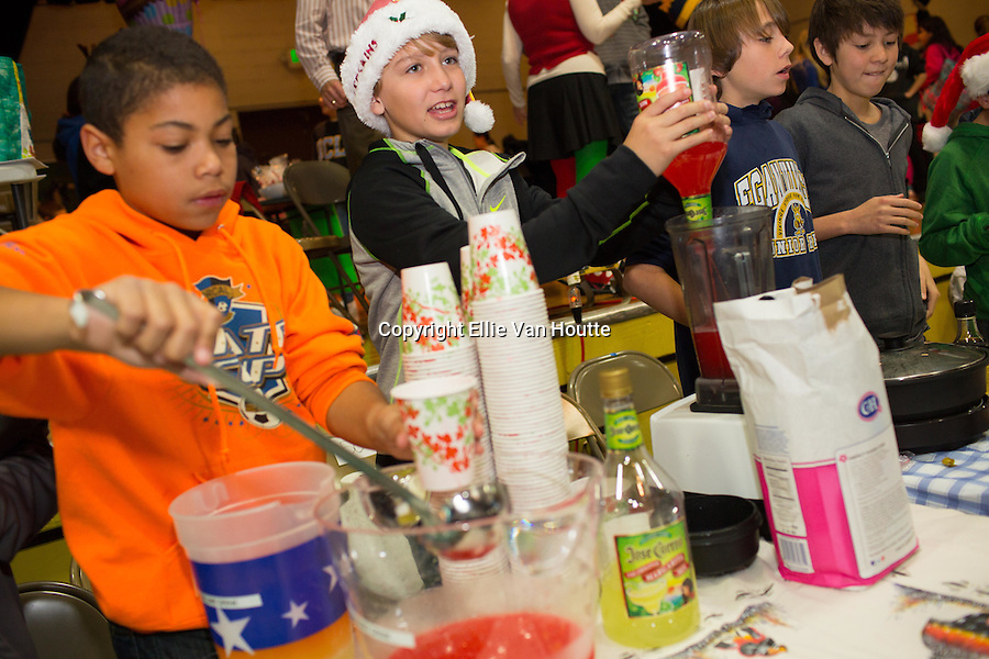 Kai Moos and Adrian Rowe, left to right, sell margaritas to classmates at the holiday faire.