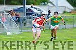 PAul Murphy  Rathmore pulls clear of Graham O'SullivanSouth Kerry during their County Championship clash in Killorglin on Saturday