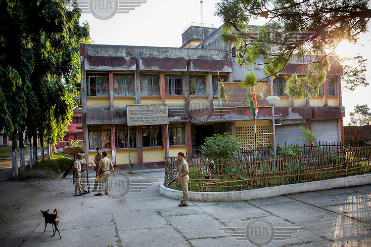 Indian policemen at the Panikanti India - Nepal border post. The border point is one of the main smuggling routes for tiger parts trafficking between India and China.