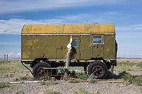 Disused military vehicles are now used as fisherman's huts at the weekend.