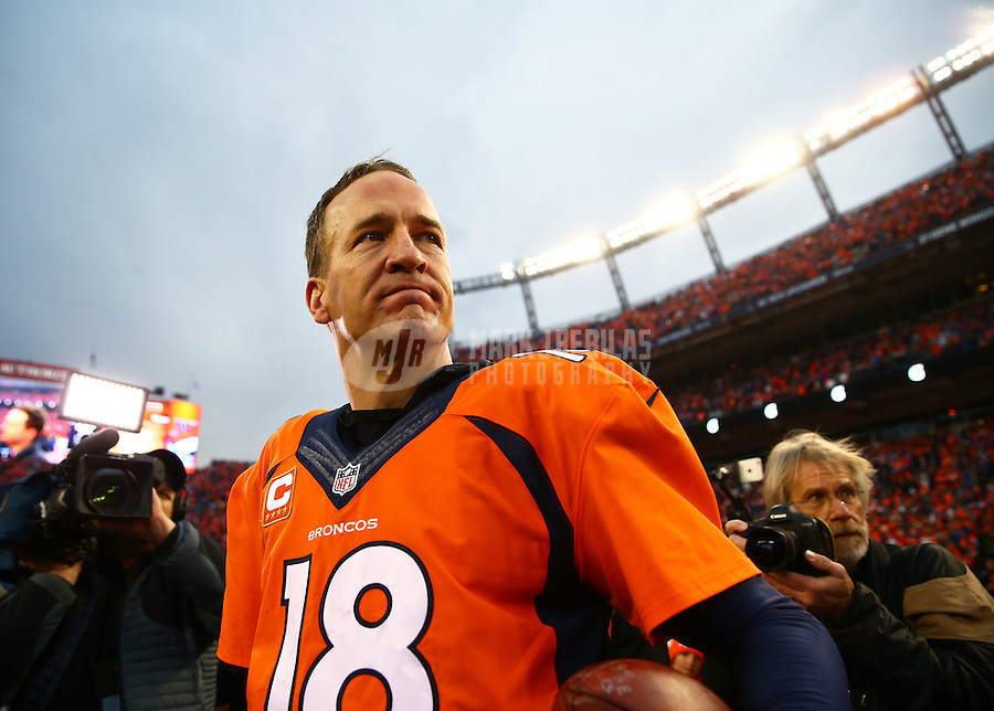 Jan 24, 2016; Denver, CO, USA; Denver Broncos quarterback Peyton Manning (18) following the game against the New England Patriots in the AFC Championship football game at Sports Authority Field at Mile High. The Broncos defeated the Patriots 20-18 to advance to the Super Bowl. Mandatory Credit: Mark J. Rebilas-USA TODAY Sports