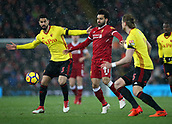 17th March 2018, Anfield, Liverpool, England; EPL Premier League football, Liverpool versus Watford; Mohammed Salah of Liverpool competes with Miguel Angel Britos and Sebastian Prodl of Watford for the ball