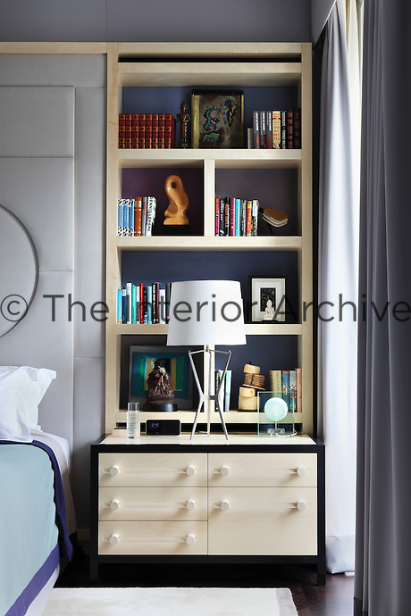 Detail of one of the built-in shelving units beside the bed in the master bedroom