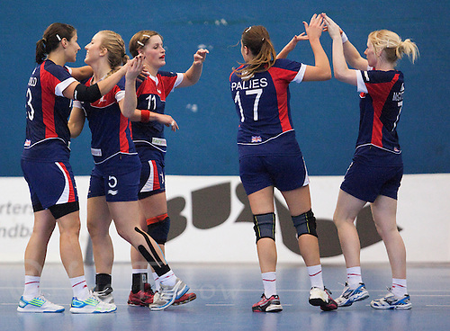 22 OCT 2011 - LONDON, GBR - British players celebrate after their Women's 2012 European Handball Championship qualification match  against Russia at the National Sports Centre at Crystal Palace. Despite losing 24-16 the relative newcomers to the sport had managed to hold the current women's World Champions and Olympic silver medalists to a much lower goal difference than had been expected (PHOTO (C) NIGEL FARROW)