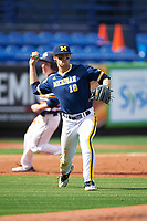 Michigan Wolverines third baseman Jake Bivens (18) throws to first base during the second game of a doubleheader against the Canisius College Golden Griffins on February 20, 2016 at Tradition Field in St. Lucie, Florida.  Michigan defeated Canisius 3-0.  (Mike Janes/Four Seam Images)