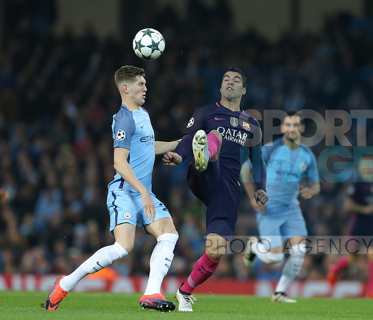John Stones of Manchester City and Luis Suarez of Barcelona during the Champions League Group C match at the Etihad Stadium, Manchester. Picture date: November 1st, 2016. Pic Simon Bellis/Sportimage