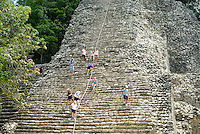 Enthusiastic visitors to the ruins at Cobá on Mexico's Yucatán Peninsula are still allowed to climb the surprisingly steep 138-foot pyramid that towers above the jungle called Nohoch Mul (large hill). The reward is a stunning panoramic view of the vast jungle below..