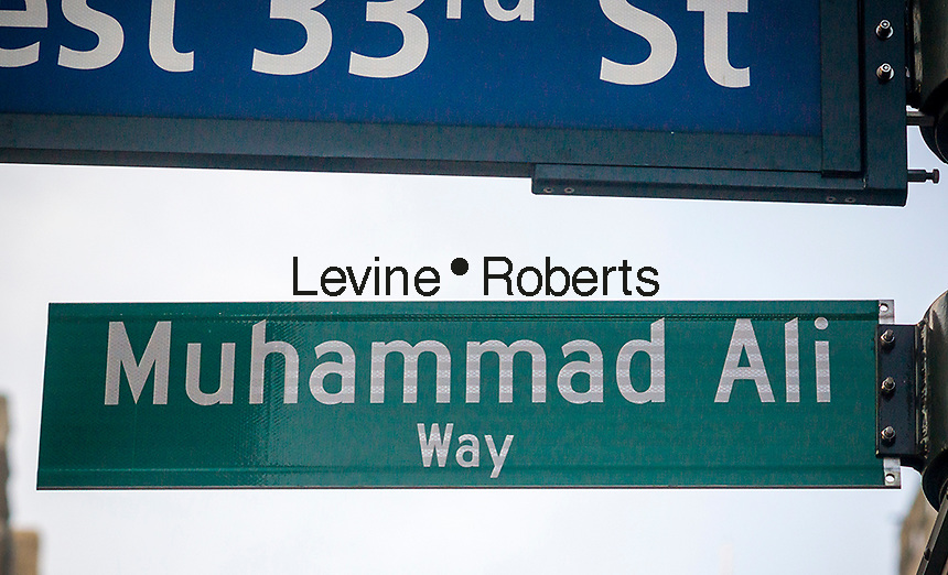 """New York commemorates the late boxing legend Muhammad Ali by temporarily renaming West 33rd Street next to Madison Square Garden as """"Muhammad Ali Way"""", seen on Tuesday, June 7, 2016. Ali fought Joe Frazier in the famous arena in 1971 in what was billed as the """"Fight of the Century"""". Ali passed away June 3 at the age of 74. (© Richard B. Levine)"""