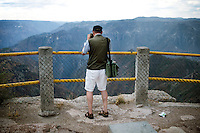 A tourist takes a photo at a stop at the Divisadero rest area, which lends to the best view and magnificent accommodations Copper Canyon has to offer at about 7,300 feet in elevation. Three canyons crisscross and meet at this point lending to the most dramatic cliffs and drops in the canyon...PHOTOS/ MATT NAGER