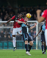 Roarie Deacon of Crawley Town & Stephen McGinn of Wycombe Wanderers go for the ball during the Sky Bet League 2 match between Wycombe Wanderers and Crawley Town at Adams Park, High Wycombe, England on 28 December 2015. Photo by Andy Rowland / PRiME Media Images