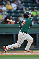 Left fielder Austin Dean (2) of the Greensboro Grasshoppers bats in a game against the Greenville Drive on Wednesday, May 7, 2014, at Fluor Field at the West End in Greenville, South Carolina. Dean is the No. 14 prospect of the Miami Marlins, according to Baseball America. Greenville won, 12-8. (Tom Priddy/Four Seam Images)