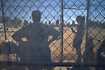A dugout view of a softball game held in San Francisco, California.