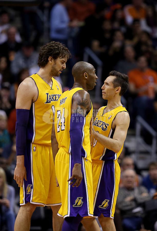 Jan. 30, 2013; Phoenix, AZ, USA: Los Angeles Lakers guard Kobe Bryant (center), forward Pau Gasol (left) and guard Steve Nash against the Phoenix Suns at the US Airways Center. Mandatory Credit: Mark J. Rebilas-