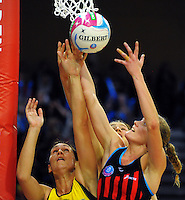 Jodi Brown and Louise Thayer (right) compete for the ball during the ANZ Netball Championship match between the Central Pulse and Mainland Tactix at Te Rauparaha Arena, Wellington, New Zealand on Saturday, 11 May 2015. Photo: Dave Lintott / lintottphoto.co.nz