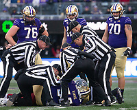Referees untangle the pile after it was determined that Aaron Fuller fumbled.