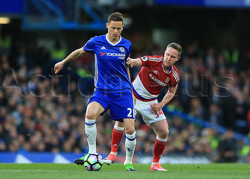 May 8th 2017, Stamford Bridge, Chelsea, London England; EPL Premier League football, Chelsea FC versus Middlesbrough; Nemanja Matic of Chelsea being intercepted by Adam Forshaw of Middlesbrough