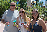 Fred Kunert, Kelli Kunert and Samantha Madison during the Reno Wine Walk in downtown Reno on Saturday, June 17, 2017.