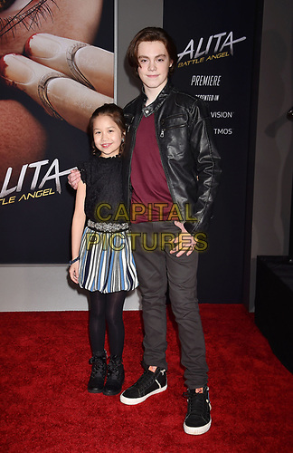 WESTWOOD, CA - FEBRUARY 05: Trinity Bliss (L) and Jack Champion attend the Premiere Of 20th Century Fox's 'Alita: Battle Angel' at Westwood Regency Theater on February 05, 2019 in Los Angeles, California.<br /> CAP/ROT/TM<br /> ©TM/ROT/Capital Pictures