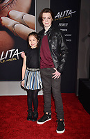 WESTWOOD, CA - FEBRUARY 05: Trinity Bliss (L) and Jack Champion attend the Premiere Of 20th Century Fox's 'Alita: Battle Angel' at Westwood Regency Theater on February 05, 2019 in Los Angeles, California.<br /> CAP/ROT/TM<br /> &copy;TM/ROT/Capital Pictures