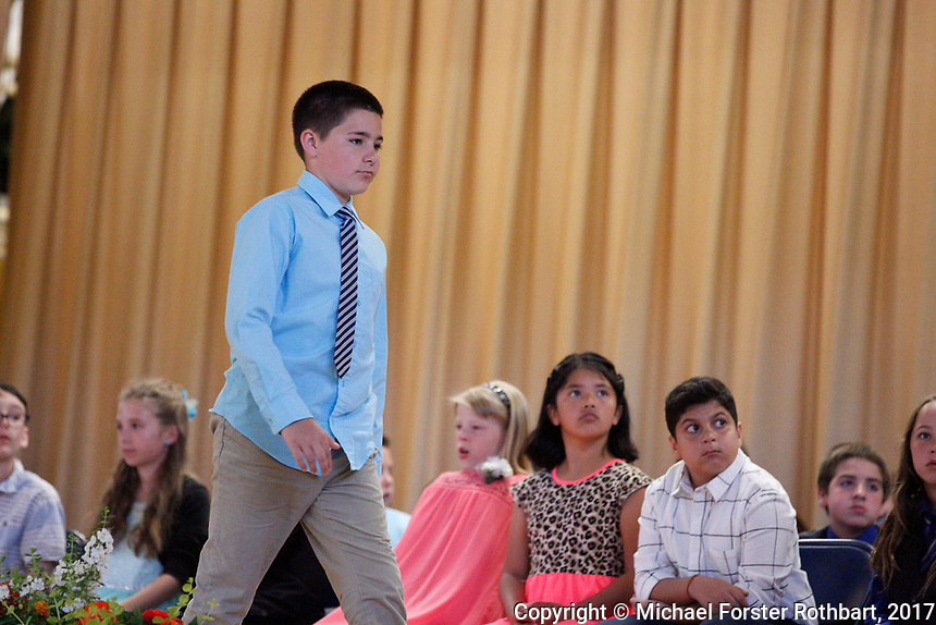 The Oneonta Greater Plains elementary school fifth grade awards ceremony, on June 21, 2017.<br /> &copy; Michael Forster Rothbart Photography<br /> www.mfrphoto.org &bull; 607-267-4893<br /> 34 Spruce St, Oneonta, NY 13820<br /> 86 Three Mile Pond Rd, Vassalboro, ME 04989<br /> info@mfrphoto.org<br /> Photo by: Michael Forster Rothbart<br /> Date:  6/21/2017<br /> File#:  Canon &mdash; Canon EOS 5D Mark III digital camera frame C19349