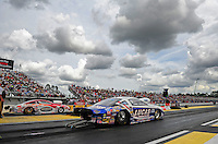 Mar. 9, 2012; Gainesville, FL, USA; NHRA pro stock driver Larry Morgan (near) races alongside Ronnie Humphrey during qualifying for the Gatornationals at Auto Plus Raceway at Gainesville. Mandatory Credit: Mark J. Rebilas-