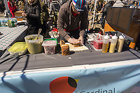 A worker prepares a sandwich at Cardinal Bakery opening day at the premiere outdoor food court, Smorgasburg in East River State Park in the Williamsburg neighborhood of Brooklyn in New York on Saturday, April 4, 2015. The marketplace features prepared and artisanal foods made in Brooklyn by small entrepreneurs. The market has provided a venue for numerous chefs and cooks to sell their wares, some of whom have grown into large successful businesses. (© Richard B. Levine)
