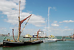 New and old sailing boats in Portsmouth Harbour, Hampshire, England