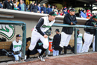 Dayton Dragons third baseman Tanner Rahier #8 runs out to the field before a game against the Bowling Green Hot Rods on April 20, 2013 at Fifth Third Field in Dayton, Ohio.  Dayton defeated Bowling Green 6-3.  (Mike Janes/Four Seam Images)