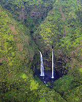 Distant waterfall in remote corner of Kauai as viewed from helicopter.