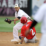 SIOUX FALLS, SD - JULY 30:  Cory Morales #5 from the Sioux Falls Canaries tries to put the tag on Josh Colafemina #2 from Trois-Rivieres as he steals second in the third inning Tuesday night at the Sioux Falls Stadium.  (Photo by Dave Eggen/Inertia)