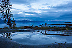 The sky reflect in a rain puddle at Yellowstone Lake at Dusk, in Yellowstone National Park, Wyoming.