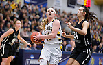 SIOUX FALLS, SD: MARCH 12:  Abby Hora #14 of Augustana drives past Sydney Skaggs #24 of Central Missouri during the 2018 NCAA Division II Women's Basketball Central Region Championship Monday at the Elmen Center in Sioux Falls, S.D. (Photo by DIck Carlson/Inertia)