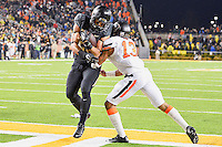 Baylor running back Devin Chafin (28) rushes in for a touchdown defended by Oklahoma State safety Jordan Sterns (13) during second half of an NCAA football game, Saturday, November 22, 2014 in Waco, Tex. Baylor defeated Oklahoma State 49-28. (Mo Khursheed/TFV Media via AP Images)