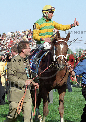 Chris Antley on Charismatic after 1999 Kentucky Derby victory.  Mike Maker at left.