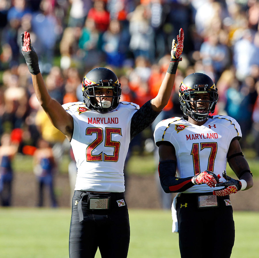 Maryland Terrapins defensive back Dexter McDougle (25) celebrates a play with teammate Maryland Terrapins defensive back Isaac Goins (17) during the game against Virginia in Charlottesville, Va. Maryland defeated Virginia 27-20.