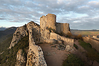 "Lower Castle, Peyrepertuse Castle or Chateau Pierre Pertuse, Cathar Castle, Duilhac-sous-Peyrepertuse, Corbieres, Aude, France. This castle consists of a Lower Castle built by the Kings of Aragon in the 11th century and a High Castle built by Louis IX in the 13th century, joined by a huge staircase. Its name means pierced rock in Occitan and it has been associated with the Counts of Narbonne and Barcelona. It is one of the ""Five Sons of Carcassonne"" or ""cinq fils de Carcassonne"" and is a listed monument historique. Picture by Manuel Cohen"