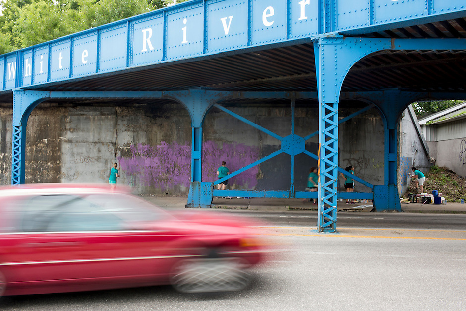 """Members work on a mural under a train bridge during """"Circle the City with Service,"""" the Kiwanis Circle K International's 2015 Large Scale Service Project, on Wednesday, June 24, 2015, in Indianapolis. (Photo by James Brosher)"""