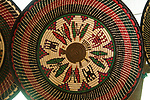 Beuatifully woven Embera baskets made from split palm leaves.  The designs are geometric and often contain plants and animals in the design, as seen here in an Embera village on Lake Alejuela in Panama. Chagres National Park