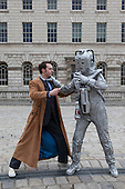 Sci-Fi fans as The Doctor and a Cyberman. About 100 Science Fiction fans dressed up as their favourite characters and gathered in the courtyard of Somerset House to head off for the 4th Sci-Fi London Annual Costume Parade. The parade was organised by Sci-Fi London 14, the London International Festival of Science Fiction and Fantastic Film. The film festival runs until 4 May 2014.