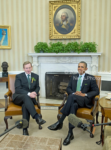 United States President Barack Obama right,, meets Prime Minister Enda Kenny of Ireland in the Oval Office of the White House in Washington, D.C. on Friday, March 14, 2014.<br /> Credit: Ron Sachs / Pool via CNP