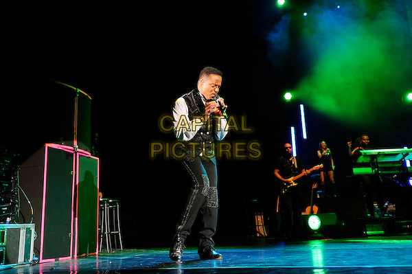 Marlon Jackson.performing in concert as part of The Jacksons, Hammersmith Apollo, London, England. .3rd March 2013.on stage live gig performance music full length black shirt black waistcoat singing  profile .CAP/MAR.© Martin Harris/Capital Pictures.